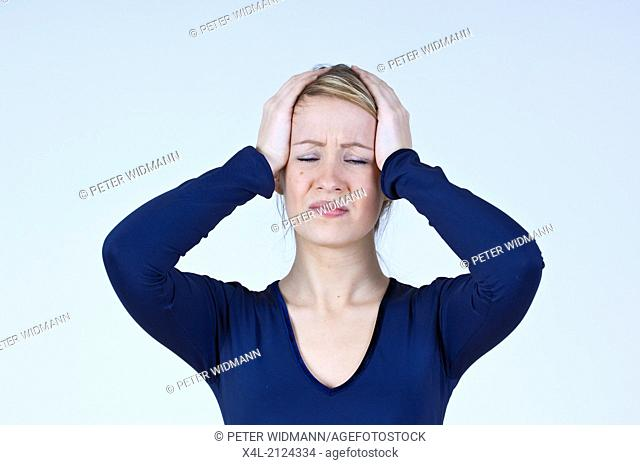 young woman with headache (model-released)