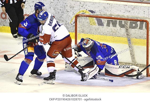 (L-R) Martin Stajnoch of Slovakia, Filip Chytil of Czech Republic, Julius Hudacek of Slovakia in action during the Euro Hockey Challenge match Slovakia vs Czech...