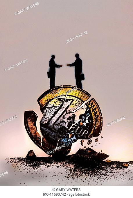 Businessmen reaching to shake hands standing on top of crumbling euro coin