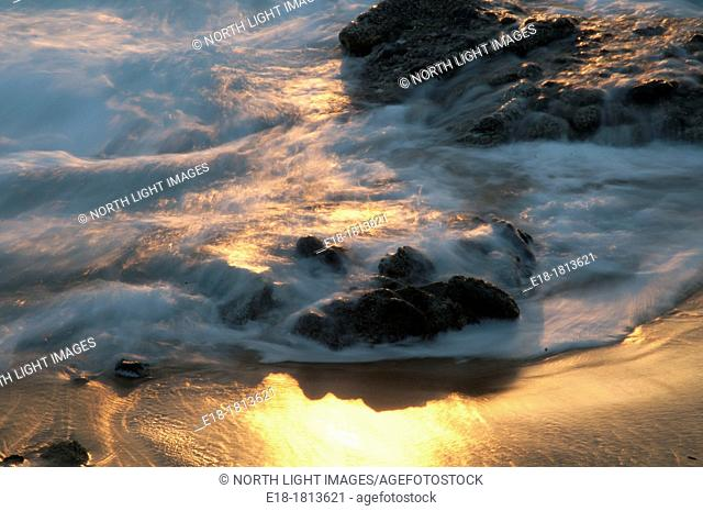 Italy, Campania, Marina di Belvedere, Waves lapping on the rocky shore of the Tyrrenian Sea