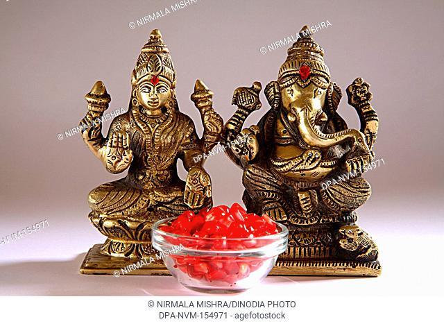Diwali deepawali festival , shree lakshmi puja with god ganesh , sweets offered , India