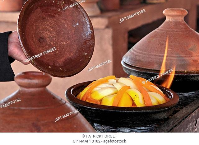THE COOKING OF TAJINES IN ONE OF THE RESTAURANTS IN THE TERRES D'AMANAR NATURE PARK, TAHANAOUTE, AL HAOUZ, MOROCCO