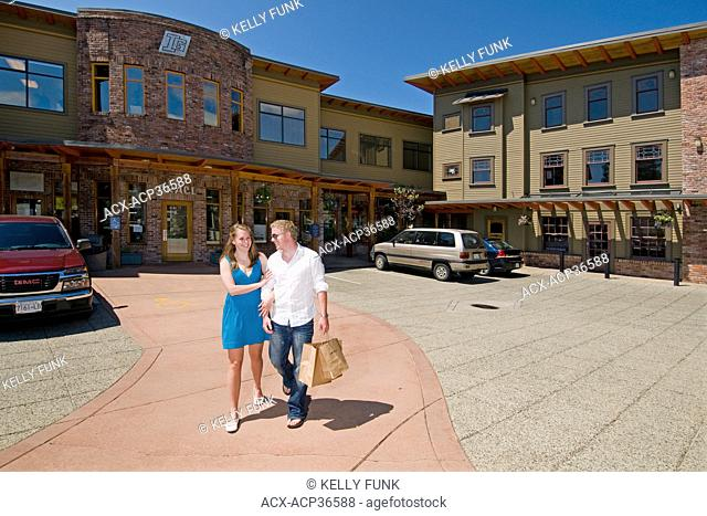 A young couple shops in Powell river on the upper Sunshine coast, Vancouver and coast mountain region, British Columbia, Canada