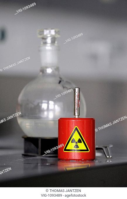 AUSTRIA, VIENNA, 22.01.2009, Red plumb container in front of a flask with an assay of Cäsium 137 in a laboratory at the Atomic Institute of the Austrian...