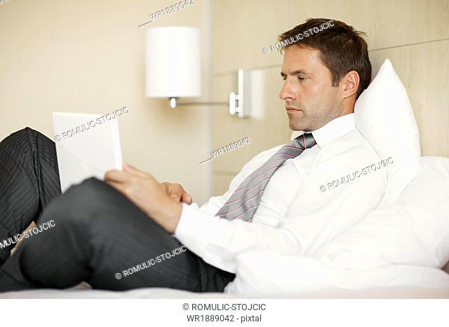 Young man using laptop in hotel room, Dubrovnik, Croatia