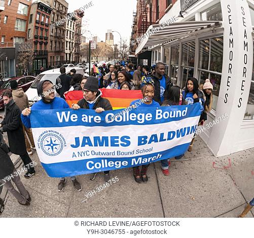 College bound students from the NYC Outward Bound James Baldwin School, cheered on by their classmates, march to the Old Chelsea Post Office in New York on...