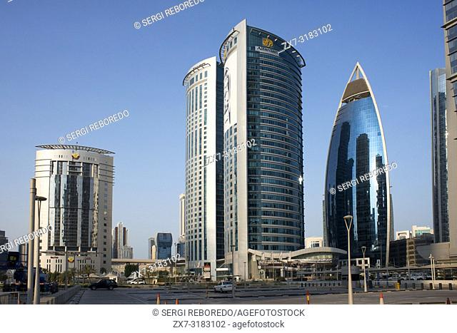View of the Alfardan Towers twin skyscrapers located in the West Bay area of Doha covered with pictures of the ruling Al Thani emir of Qatar