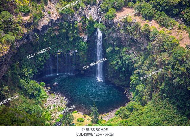 High angle view of rainforest waterfall and circular lake, Reunion Island