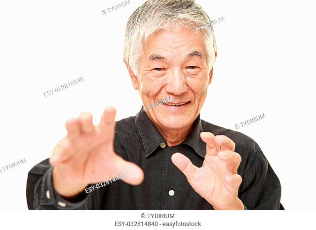 studio shot of senior Japanese man in a black shirt on white background