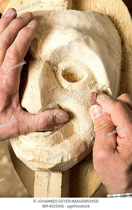 Sanding the face of a wooden mask, wooden mask carver, Bad Aussee, Styria, Austria