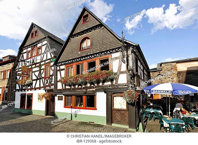 The restaurant Münze in a beautiful old half timbered house, Bacharach on the Rhine, Rheinland-Pfalz, Germany