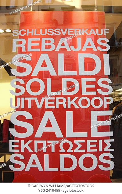 Multilingual sales sign in shop window in rome italy