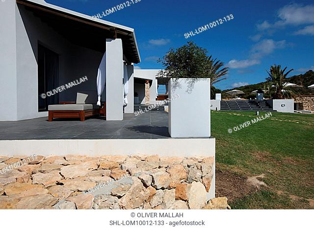 Stones and patio along modern home