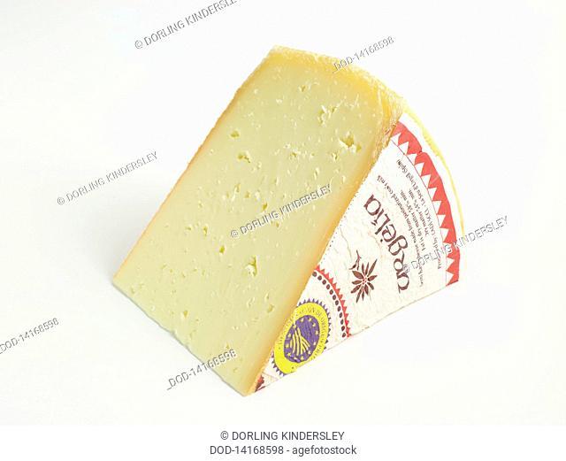 Slice of Spanish L'Alt Urgell y La Cerdanya DOP cow's milk cheese