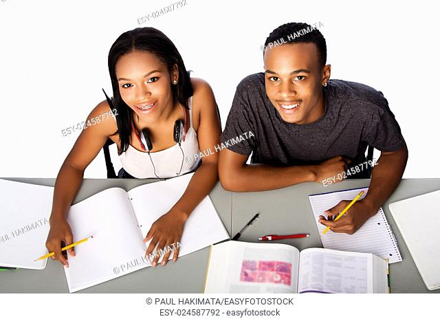 Two happy smiling academic students studying together, on white
