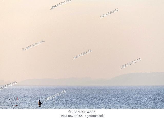 Angler in sunset