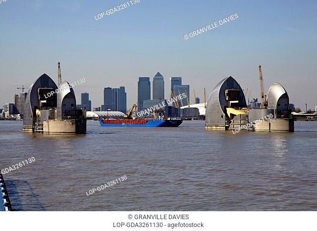 England, London, Woolwich. View over the River Thames of the Thames Barrier, O2 and skyscrapers in Canary Wharf
