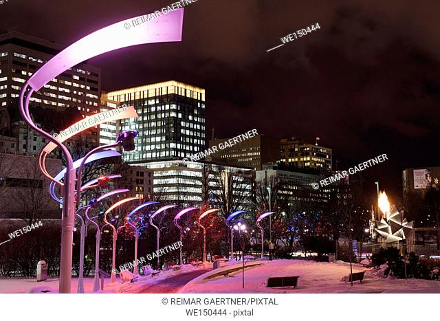 Marion Dewar Plaza Ottawa City Hall at night with Christmas lights and Canada 150th birthday cauldron flame