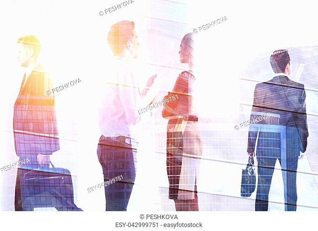 Businesspeople on abstract city background. Meeting and crowd concept. Double exposure
