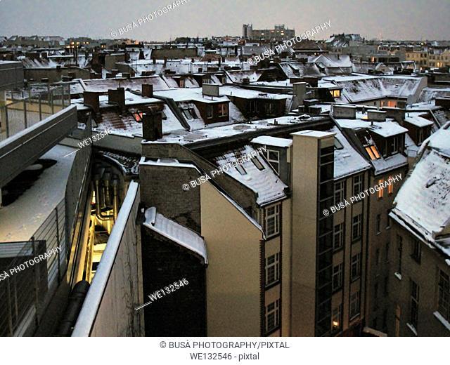 Rooftops of Berlin under the snow, twilight scene