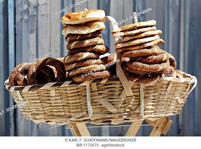 Basket with sesame bread, Simit, street vendors, Istanbul, Turkey