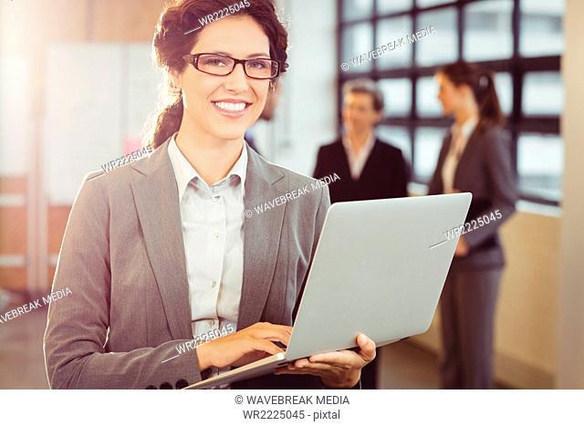 Businesswoman using her laptop
