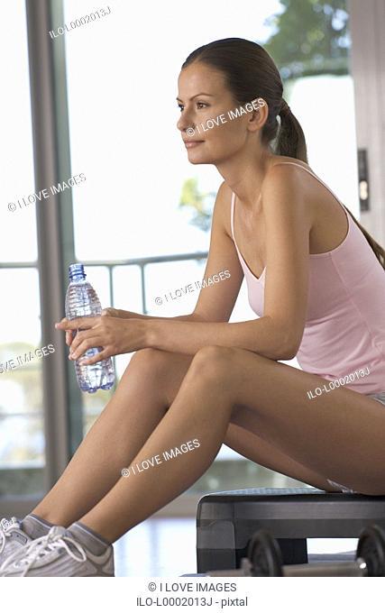 A woman sitting in a gym