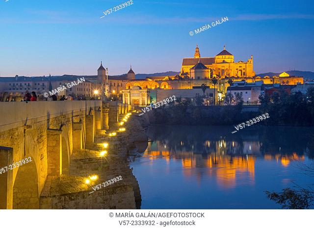 River Guadalquivir, Roman bridge and Mosque Cathedral, night view. Cordoba, Spain