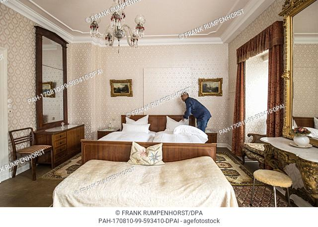 A hotel employee doing the bed in room 10 of the Hotel Villa Grunewald, where Elvis Presley stayed between October 1958 and February 1959, in Bad Nauheim
