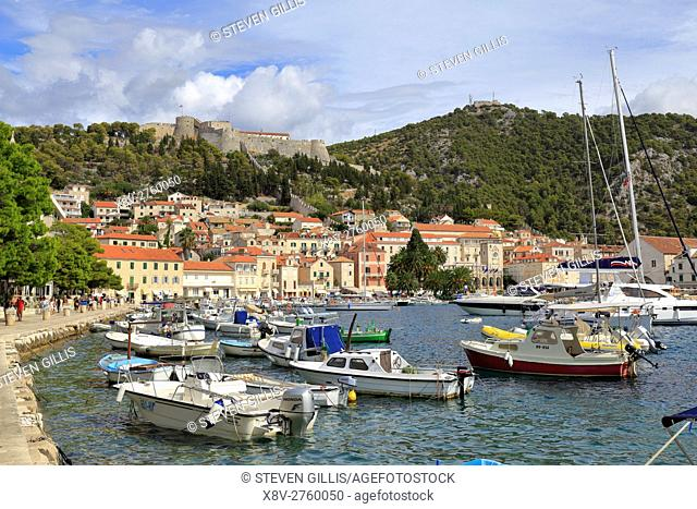 Boats in the harbour waterfront below the Spanish Fortress, Hvar Town, Croatia, Dalmatia, Dalmatian Coast, Europe