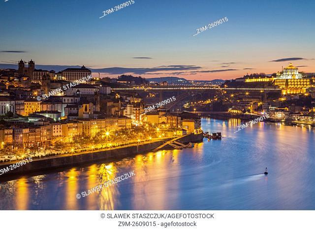 Dawn in Porto, Portugal. Looking along river Douro towards Luiz I Bridge