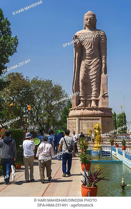 Giant standing buddha statue, sarnath, uttar pradesh, india, asia