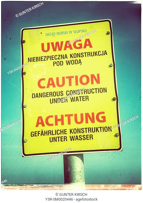 Danger Sign at the beach of the Baltic Sea in Kolobrzeg, West Pomeranian, Poland, Europe