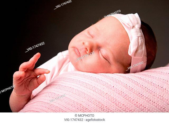 Sleeping Beauty. Studio photo of 14 days old newborn baby girl sleeping on blanket - 01/01/2009