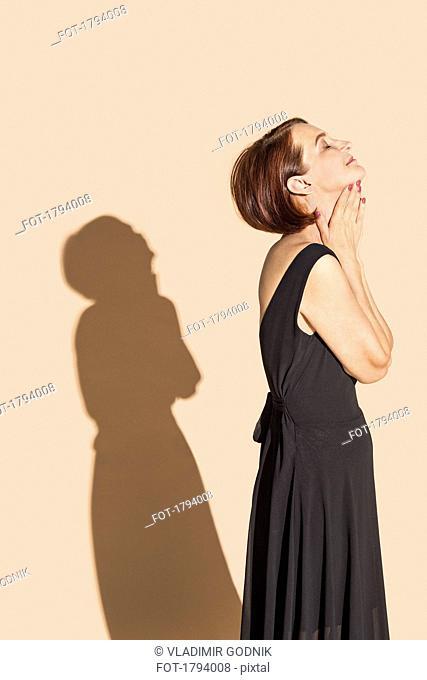 Serene woman in black dress