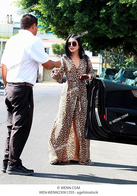 Vanessa Hudgens leaves Nine Zero One Salon in West Hollywood wearing a leopard print maxi dress Featuring: Vanessa Hudgens Where: Los Angeles, California