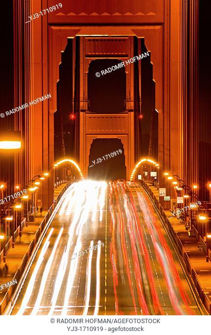 the Golden Gate Bridge traffic at night, San Francisco, California, USA