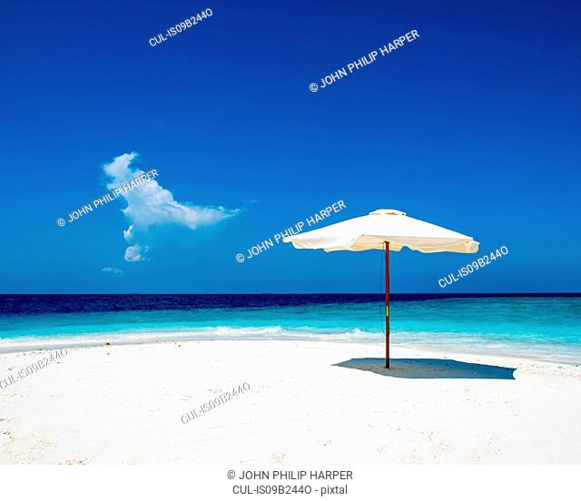 Umbrella on white sand beach, Maldives