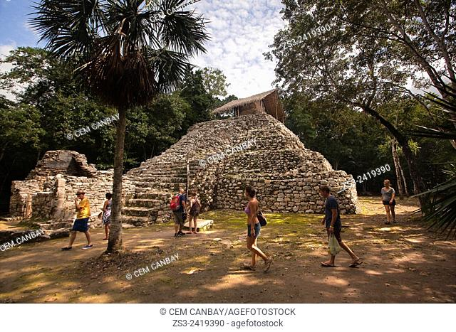 Tourist walking around the Conjunto Pinturas-Paintings Complex at the Prehispanic Mayan city of Coba Archaeological Site, Quintana Roo, Yucatan Province, Mexico