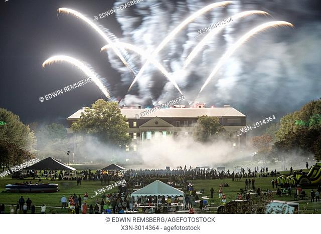 Crowd watches as firework specular goes off from McKeldin Library at University of the Maryland College Park, Maryland, USA