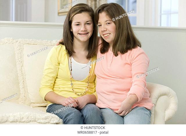 Two teenage girls sitting together