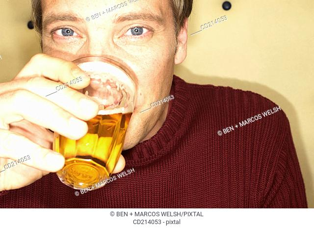 Man drinking beer, close-up