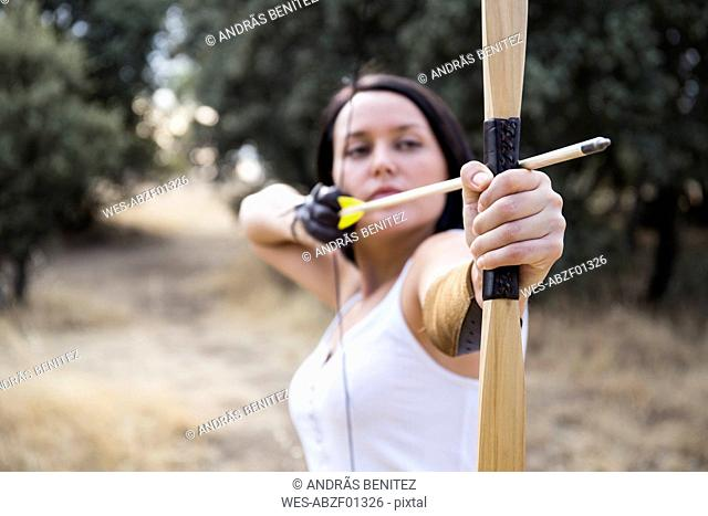 Archeress aiming with a bow
