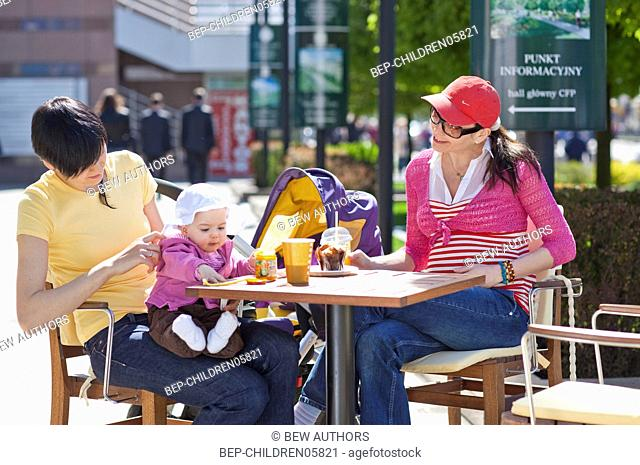 Two mothers having lunch