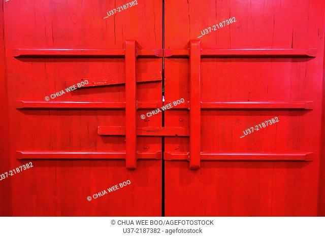 Red wooden doors with locks, Xiao Song City, Zhengzhou, Henan, China