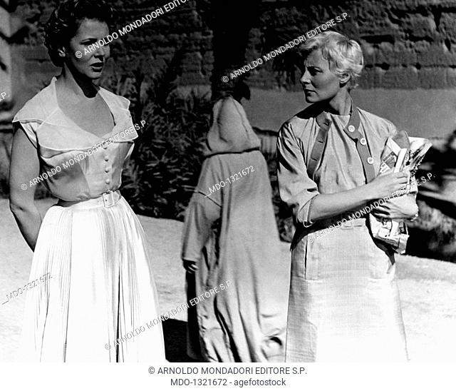 Michèle Morgan and Cornell Borchers in 'Oasis'. The French actress Michèle Morgan (Simone Renée Roussel) and the German actress Cornell Borchers acting in...