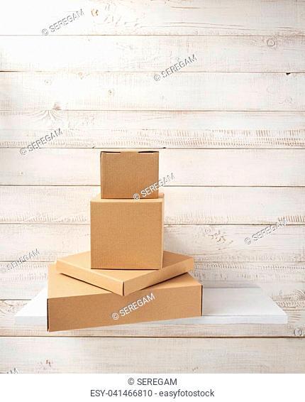 cardboard box on white wooden shelf