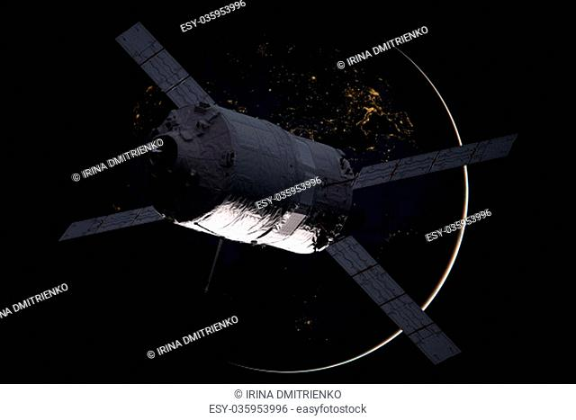 Cargo spacecraft - The Automated Transfer Vehicle over the planet Earth. Elements of this image furnished by NASA