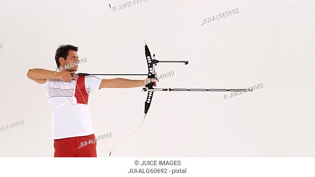 Male archer aiming, side view