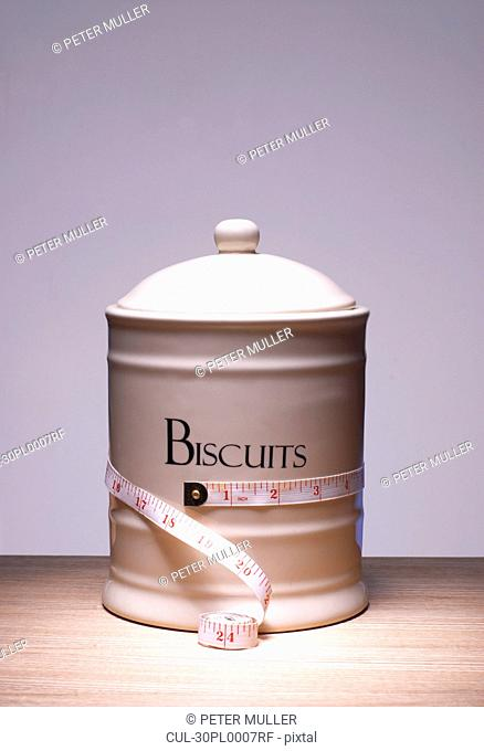 Biscuit jar with tape measure around it
